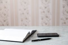 Notepad pen smartphone Royalty Free Stock Photo