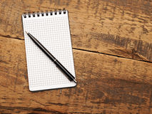 Blank notepad with pen on wood table Stock Photos