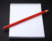 Blank notepad and a pencil on black Royalty Free Stock Photography