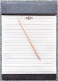 Blank notepad with pencil on the brown clipboard. Stock Photo