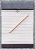 Blank notepad with pencil on the brown clipboard. Royalty Free Stock Photo