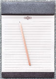 Blank notepad with pencil on the brown clipboard. Royalty Free Stock Photos