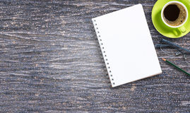 Blank notepad and pencil with cup of coffee on wooden Royalty Free Stock Image