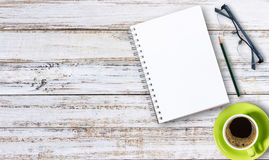 Blank notepad and pencil with cup of coffee on wooden Stock Photos