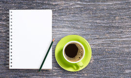 Blank notepad and pencil with cup of coffee on wooden Stock Photography