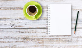Blank notepad and pencil with cup of coffee on wooden Royalty Free Stock Images