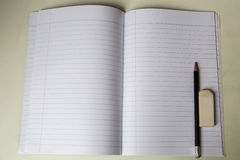 Blank notepad with pencil and eraser on table. Blank notepad with pencil and eraser on white table Royalty Free Stock Photos