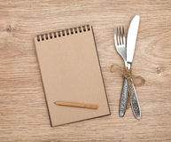Blank notepad with pencil and silverware set Stock Photo