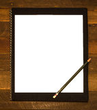 Blank notepad. And pencil on wooden background royalty free stock images