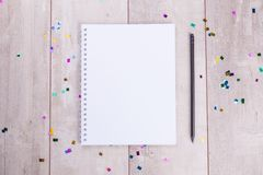 Blank notepad and pencil on the wooden table Royalty Free Stock Photo