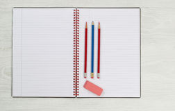 Blank notepad with pencils and eraser on desktop Stock Photo