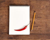 Blank notepad for recipes with pepper for your grocery list Stock Image