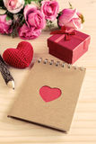 Blank notepad with red gift box and red heart shape Royalty Free Stock Image