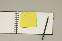 Blank notepad with sticky notes Royalty Free Stock Images