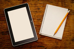 Blank notepad with a tablet computer and pencil Stock Images
