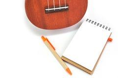 Blank Notepad  and Ukulele Stock Photo