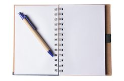 Blank notepad on white. Blank notepad with a pen on white stock photos