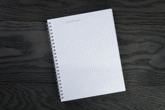 Blank notepad with wishlist on gray wood table Stock Photography