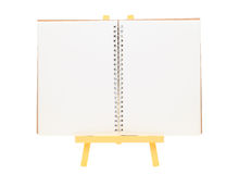 Blank notepad and wooden easel Stock Image