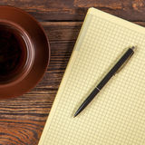 Blank notepad on a wooden table Royalty Free Stock Images