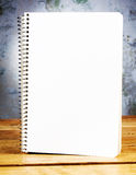 Blank notepad on wooden table Stock Images