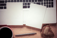 Blank notepad on wooden table Stock Photography