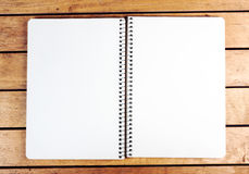 Blank notepad on wooden table Royalty Free Stock Image