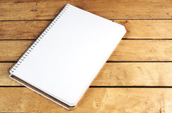 Blank notepad on wooden table Royalty Free Stock Photography