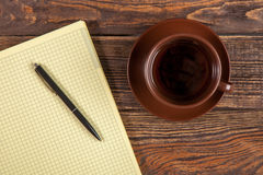 Blank notepad on a wooden table Stock Image