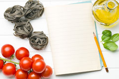 Blank notepaper and ingredients. The blank notepaper and ingredients Royalty Free Stock Photo