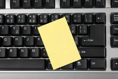 Blank notepaper on keyboard Stock Photography
