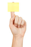 Blank notepaper stick on hand. With white background Royalty Free Stock Photography
