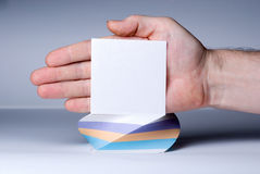 Blank notepaper stick on hand Stock Images