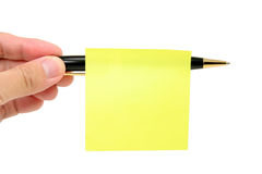 Blank notepaper stick on a pen Stock Photo