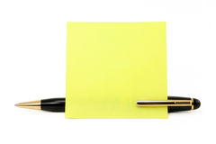 Blank notepaper stick on a pen. Blank notepaper stick on pen with white background Stock Image