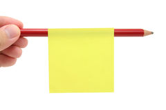 Blank notepaper stick on a pencil Royalty Free Stock Image