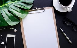 Blank notepaper with tropical leaves and accessories laying on table Royalty Free Stock Photo