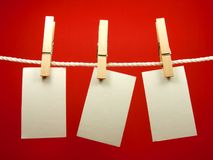 Blank notes hang on rope. Blank pieces of paper hang on clothesline Royalty Free Stock Photos
