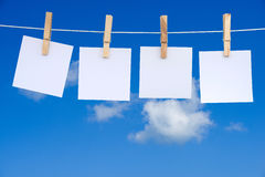 Blank notes hanging on a rope Royalty Free Stock Image