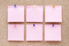 Blank notes and multicolored thumbtacks Royalty Free Stock Images