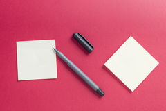 Blank notes with a pen and red background Stock Images