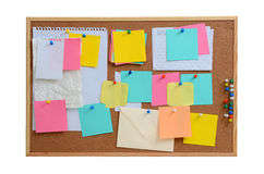 Blank notes pinned into brown corkboard Stock Images