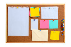 Blank notes pinned into brown corkboard Royalty Free Stock Image