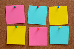 Blank notes pinned into brown corkboard Stock Photos