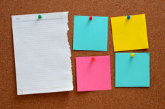 Blank notes pinned into brown corkboard Royalty Free Stock Photography