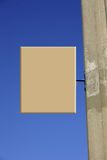 Blank notice. Board attached to concrete post against clear blue sky for your own wording or symbol or sign royalty free stock photos