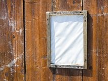 Blank notice-board on wooden background. With copy space stock images