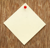 Blank notice with pushpin. On wooden surface royalty free stock photography
