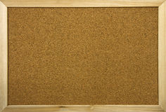 Blank office cork board with wooden frame royalty free stock photo