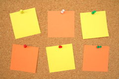 Blank office notes. Blank yellow and orange office notes Royalty Free Stock Photo